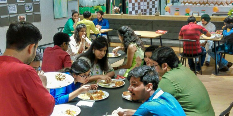 Employees at Spaces enjoying the food and celebrations