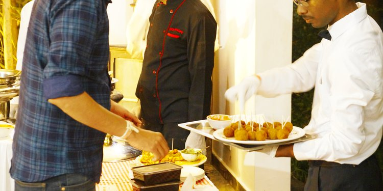 Steward Serving to the Guest
